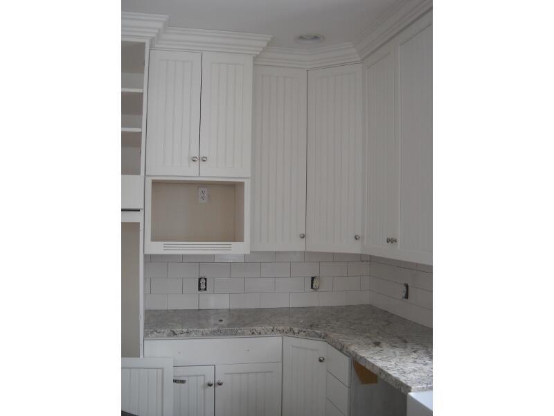 Right White Bead Board Maple Cabinets